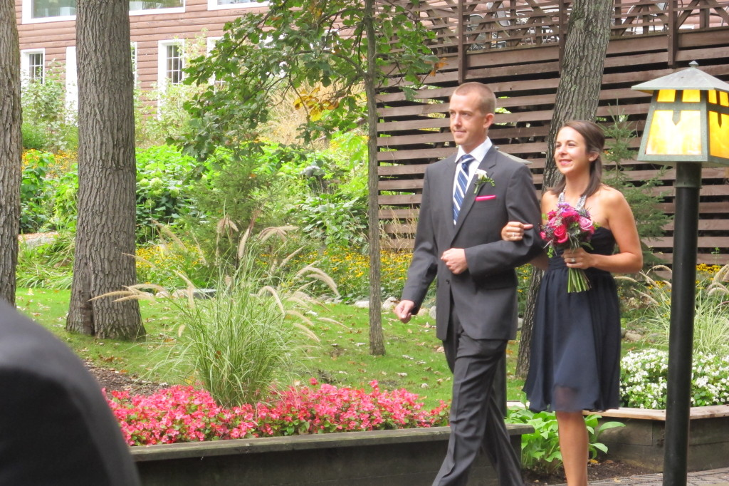 Best man & matron of honor walking down the aisle.