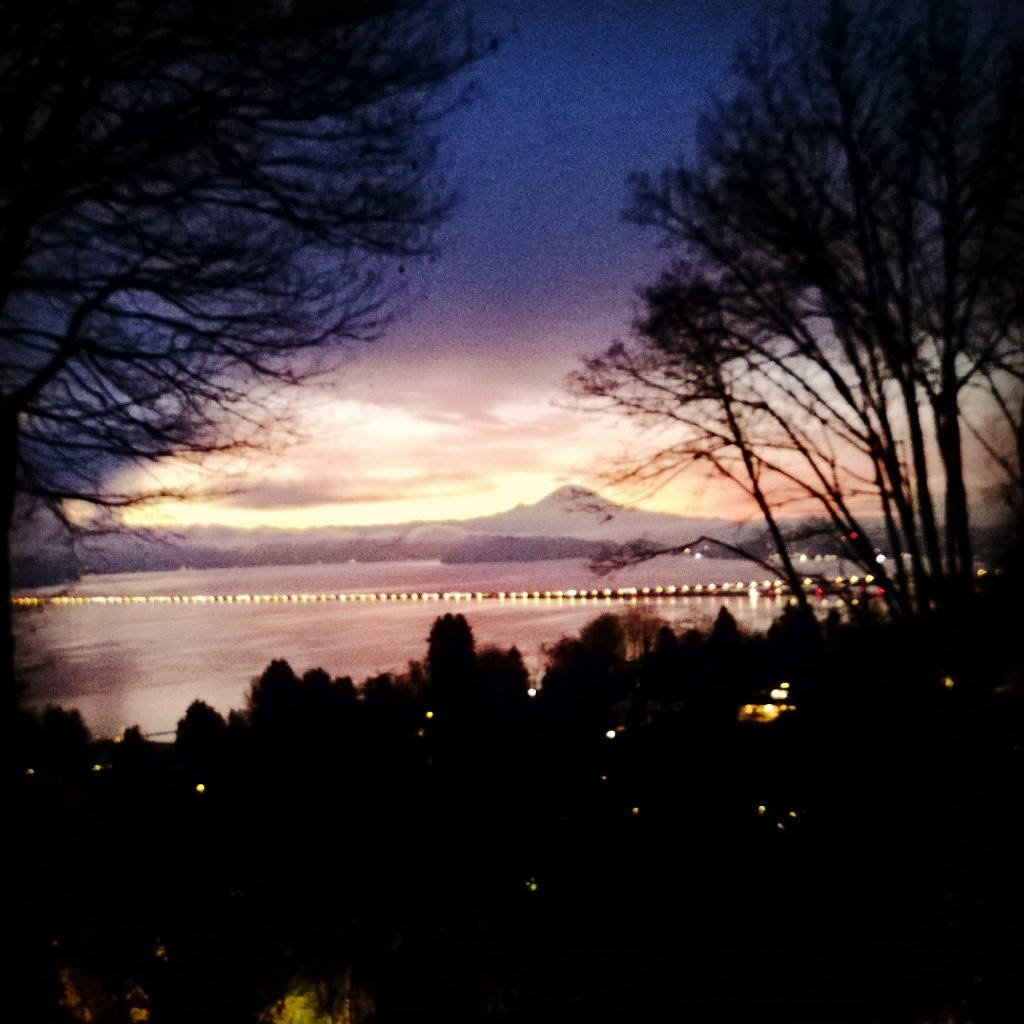 Sunrise over Lake Washington and the Cascade Mountains with Mount Rainier.
