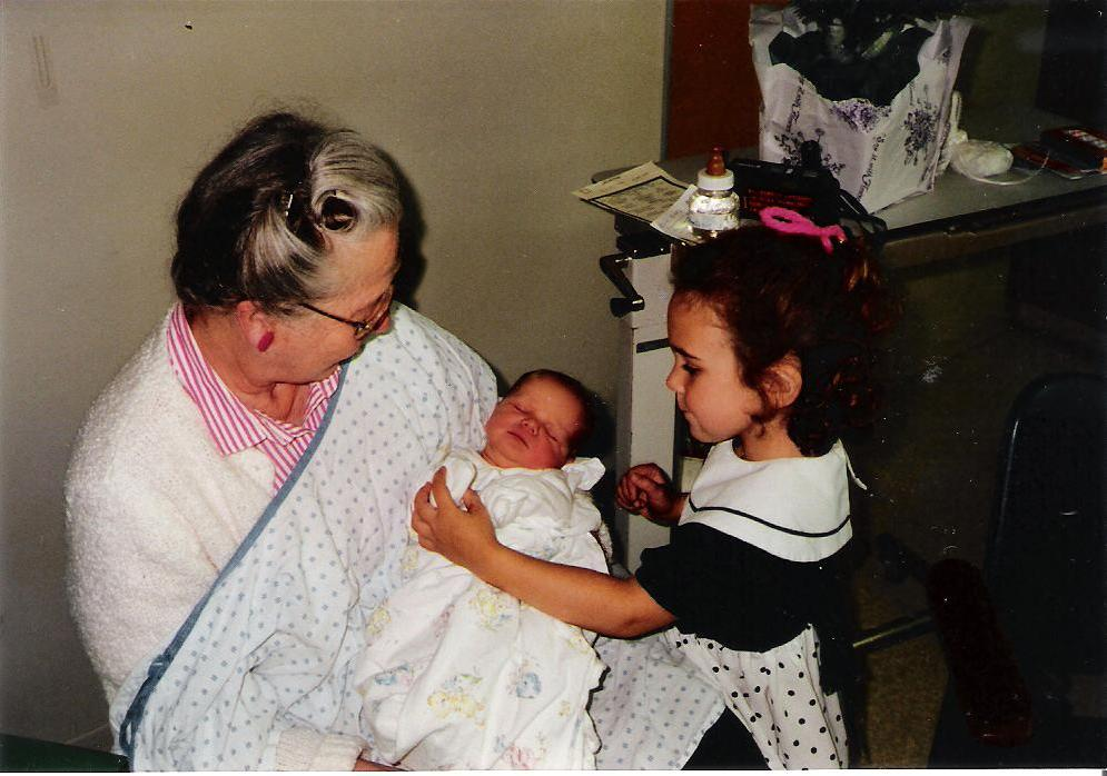 Holding her grandson for the first time. 1990