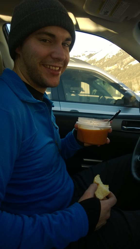 Eating soup and a roll in the car after skiing.