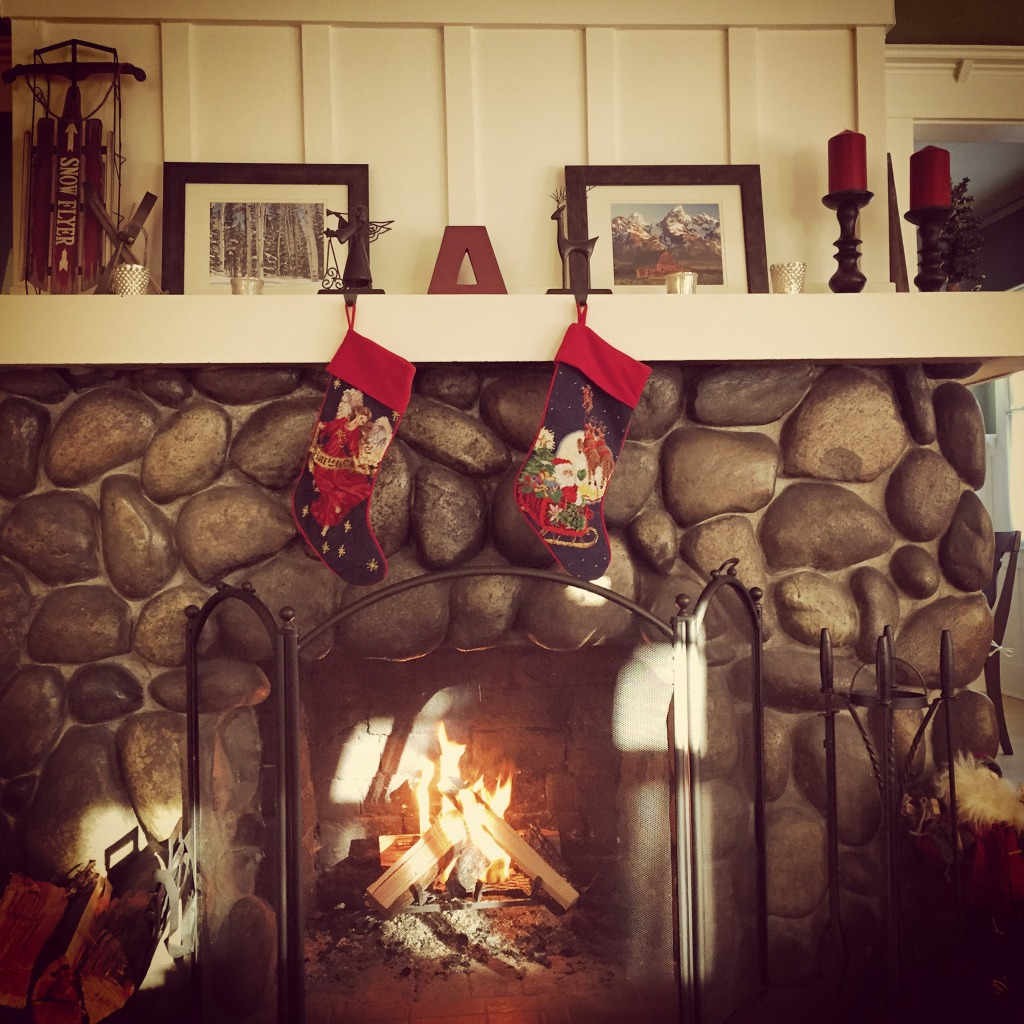 {We have been enjoying spending time in front of the fireplace, especially all decorated for the holidays!}