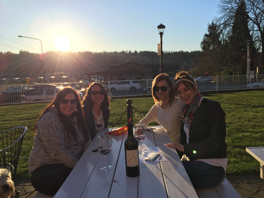{The girls enjoying a very sunny, warm afternoon drinking wine together}