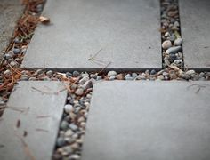 {pavers with river rocks in between will hopefully become our new patio/walkway}