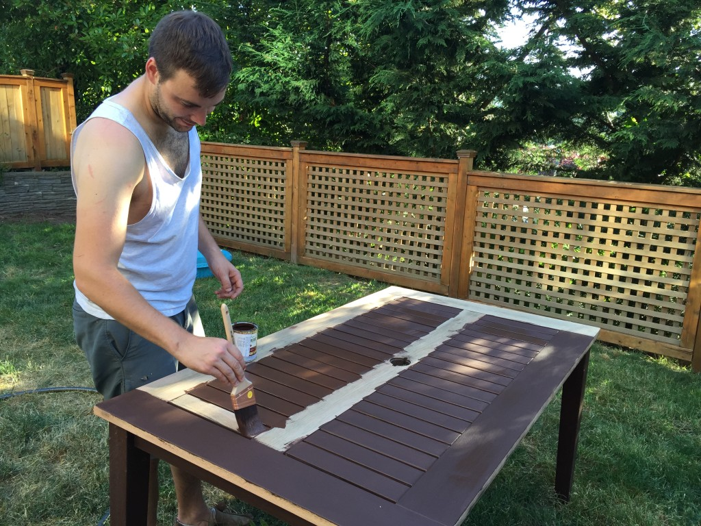 {the big project for sunday was staining the back patio table and the fence. it's our first time staining the table and it looks brand new! alex sanded it down and applied some stain and voila!}