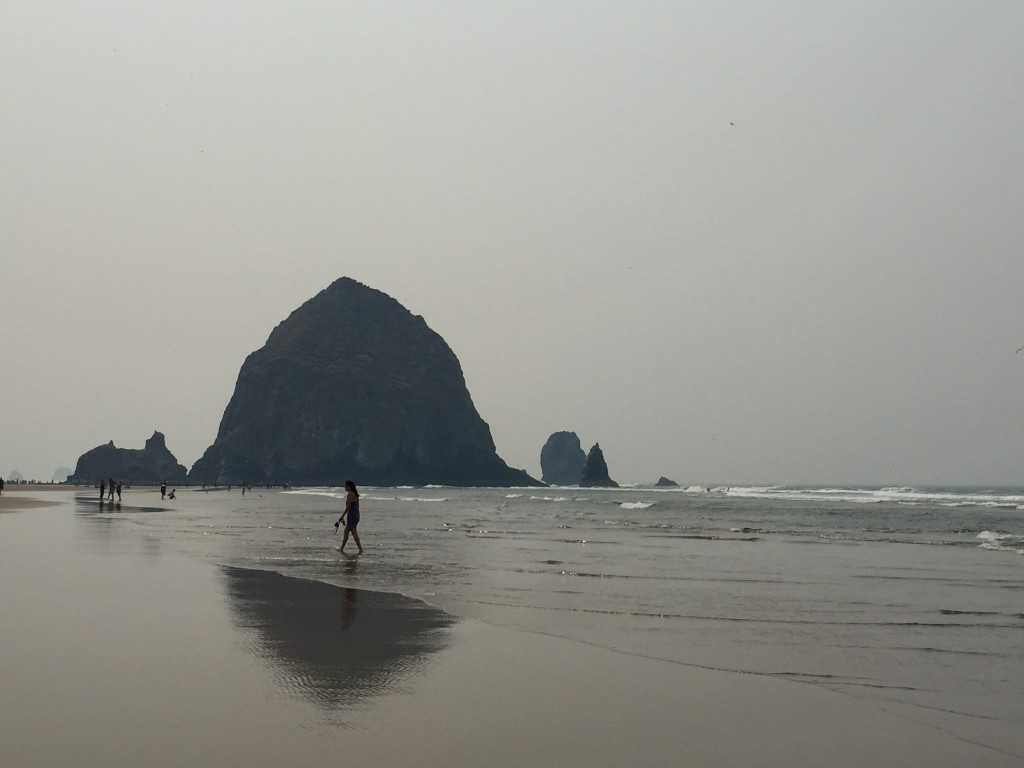 {The famous Haystack Rock that juts out of the beach.}