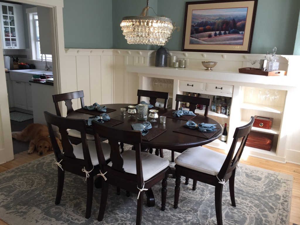 {AFTER! We are loving our new chandelier, rug and tabletop accessories. Somewhere along the line we got cushions for the chairs, but that was a while ago.}
