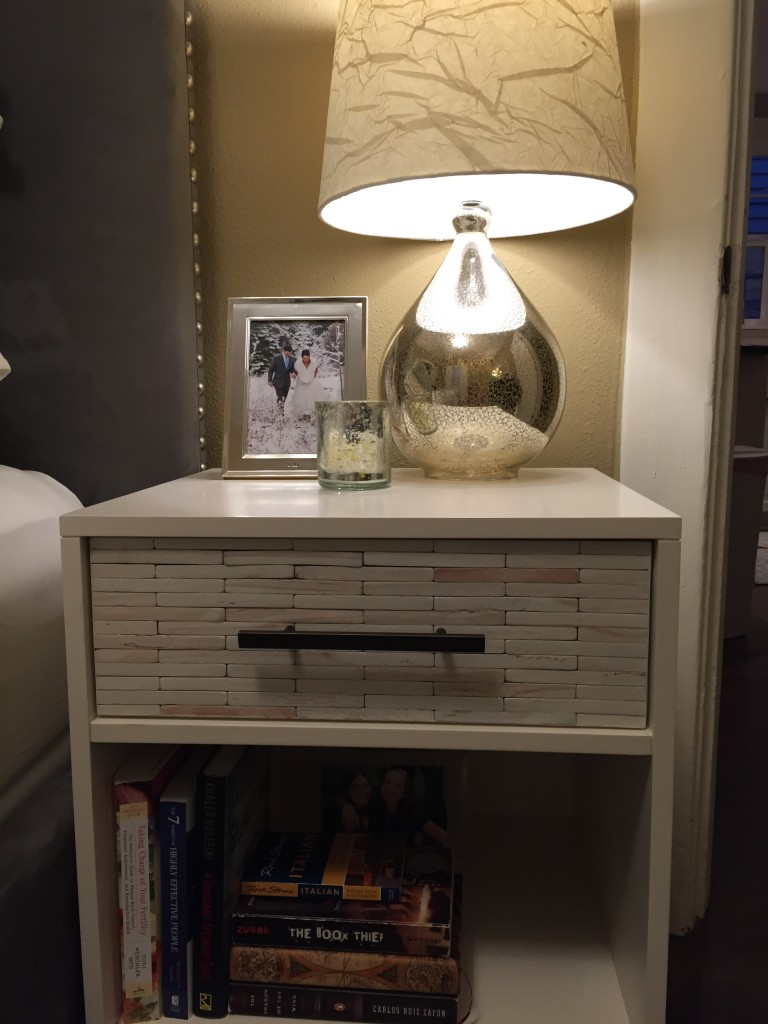 {AFTER: our funky new nightstands which we LOVE. It is so nice to have more surface area and bigger drawers for storage. These nightstands help jazz up the room and we're loving the new lamps as well.}
