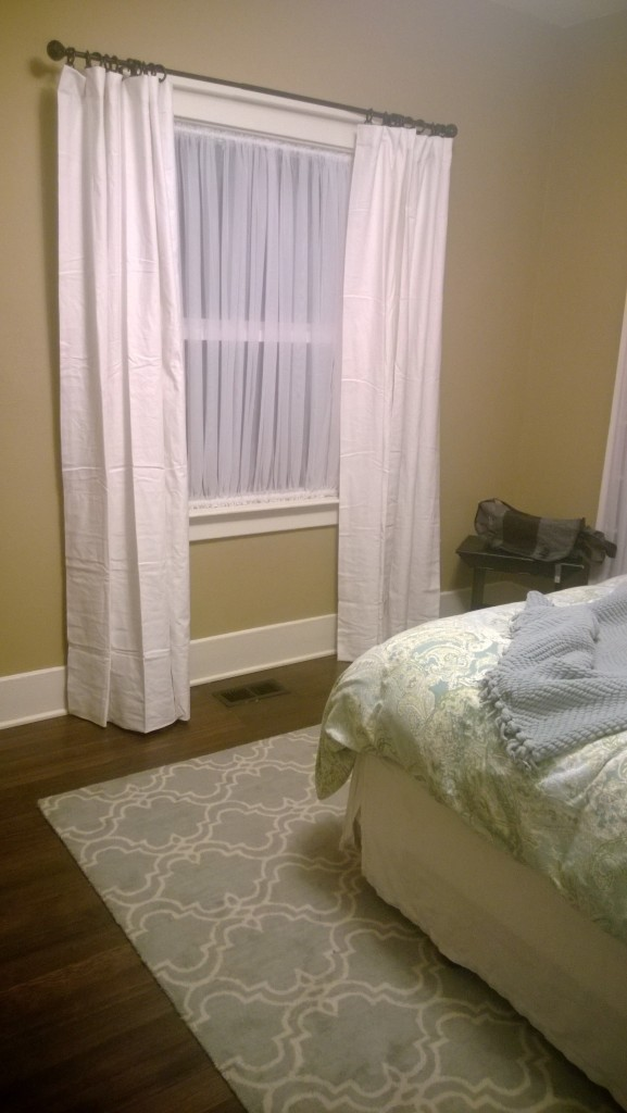 {BEFORE/AFTER -  new curtains! Still looks the same, minus the table in the corner.}