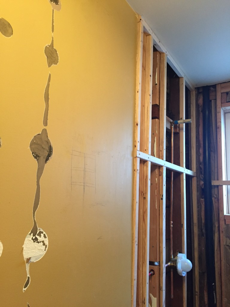 "{you can see the difference of how much the ""shimmed"" wood sticks out from the drywall how un-level the wall is!}"