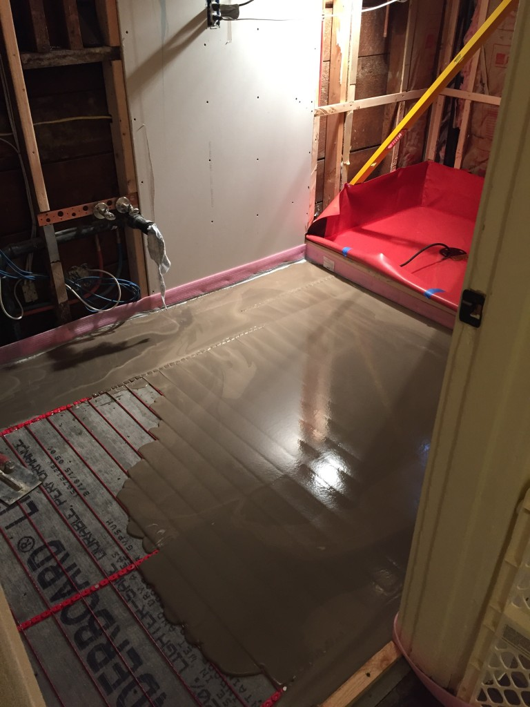 {the new cement floor base is being poured!}