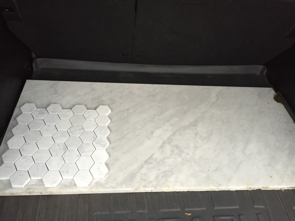 {Here is the slab I picked out. it is placed next to the hexagon tile that will be on the floor. I'd say it's a good match!}