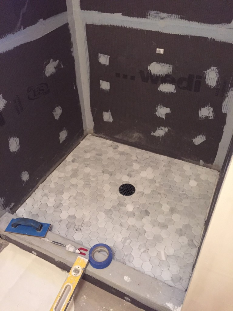 {The shower floor without grout.}