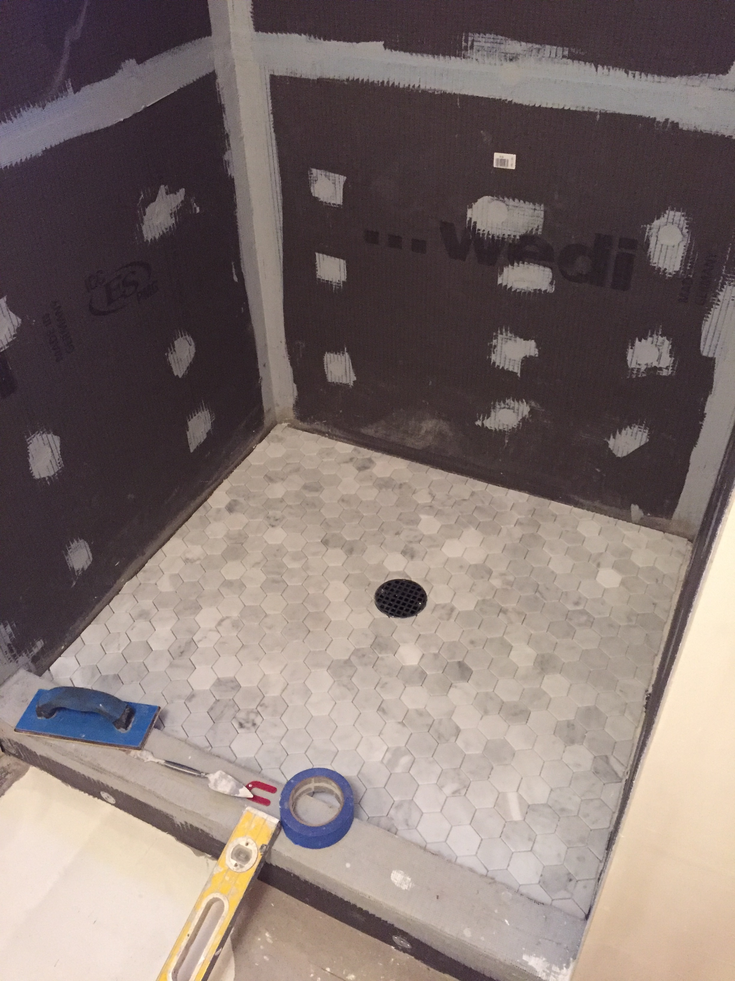 Bathroom renovation keeping up with the allens for Bathroom floors without grout