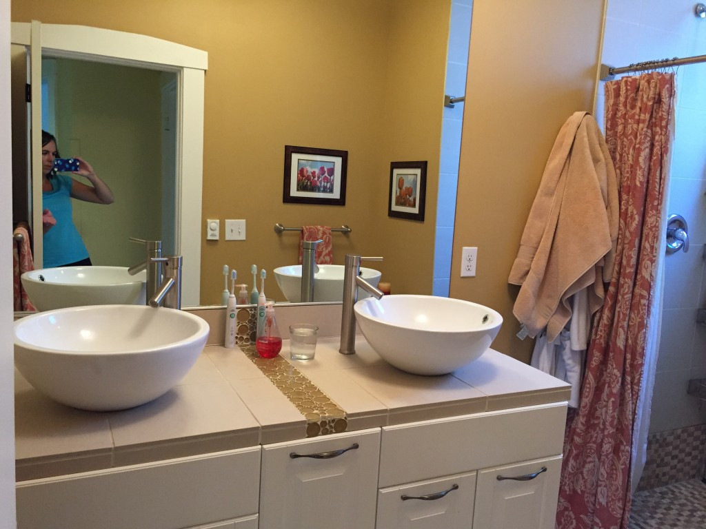 {These sinks are my least favorite part of our entire house. The faucet on the right cracked a few months after we moved in and we never fixed it because we knew we'd replace the whole thing, so we've literally had one non-functioning sink for FIVE years!}