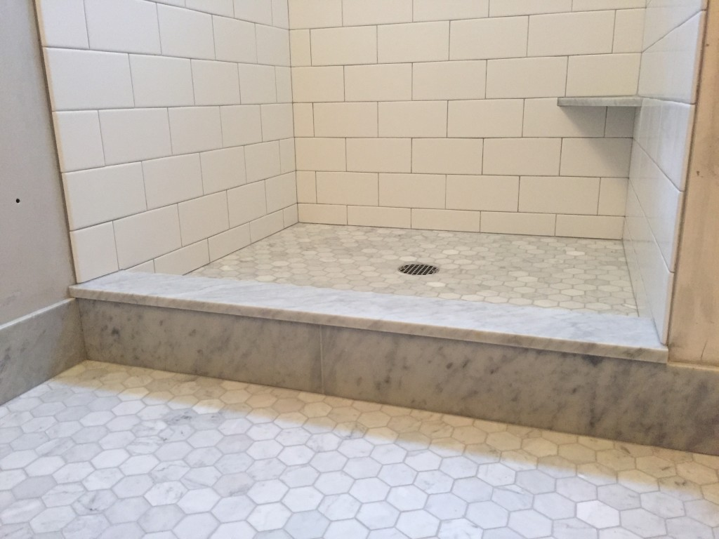 {We opted for a mid-gray grout to pull the grays out of the marble and tie everything in together. We are really liking how it looks with the subway tiles too.}