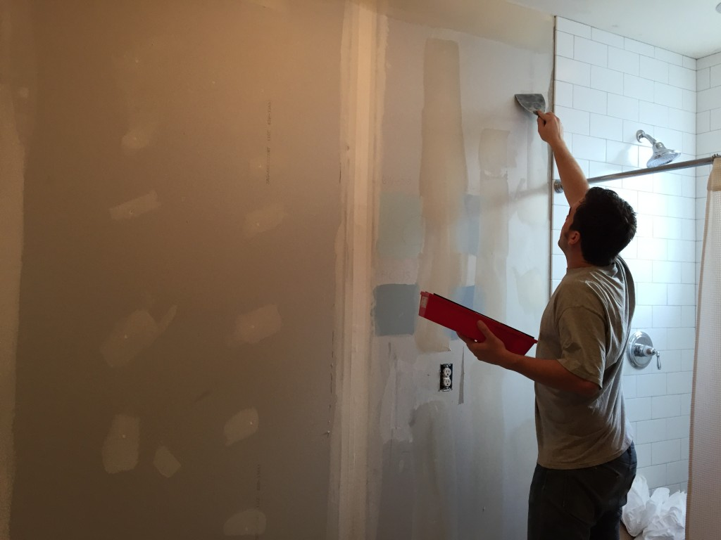 {This morning John finished the second coat of mud to cover up the screws and tape on the drywall.}