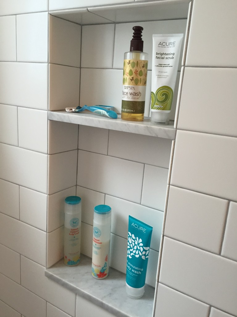 {AFTER! The custom features, like this niche, and our little footrest in the shower, have been so nice to have!}