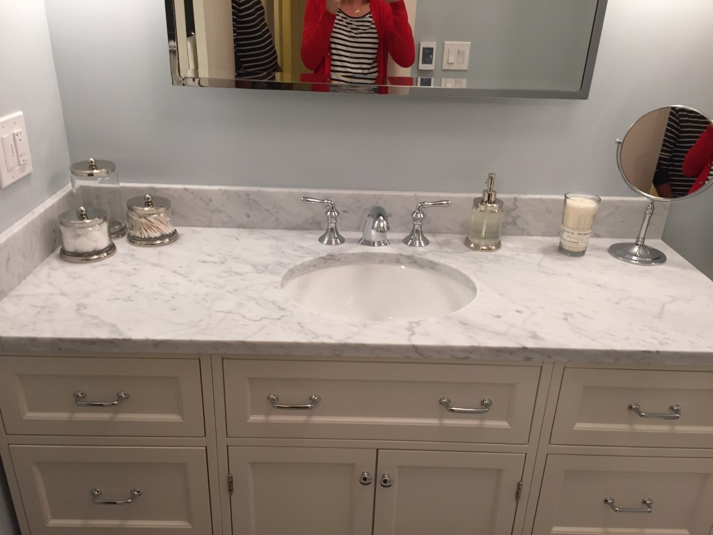 {Close-up of the gorgeous counter and sink... and me in the mirror! Hi!}