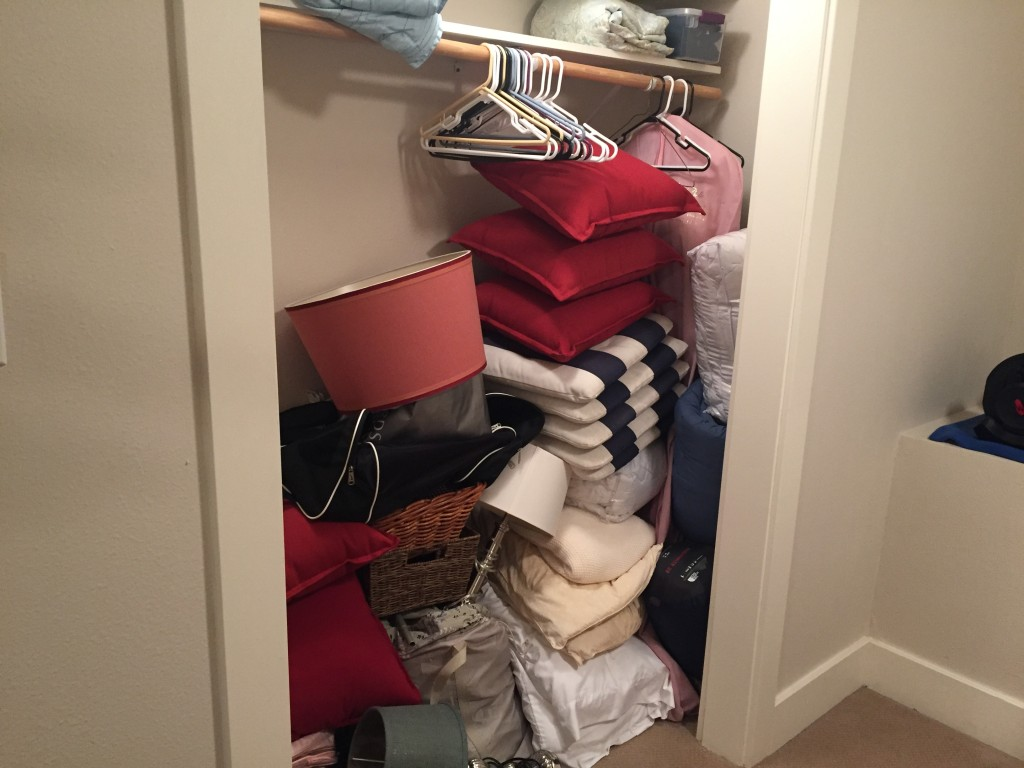 {Guest room closet before was a total free-for-all with only one shelf - makes it kind of hard to stay organized!}
