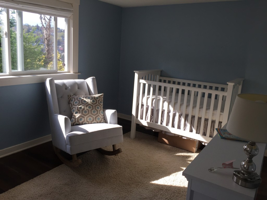 {The nursery is such a bright room - we absolutely love it! We've got some floating shelves to hang to the right of the window to store books, then over the crib will be a mountain garland I found on Etsy. On the wall above the dresser will be some cute outdoor-themed prints. I'm on the hunt for some fun storage baskets for baby toys and gear, then we'll find a small side table for next to the rocker.}