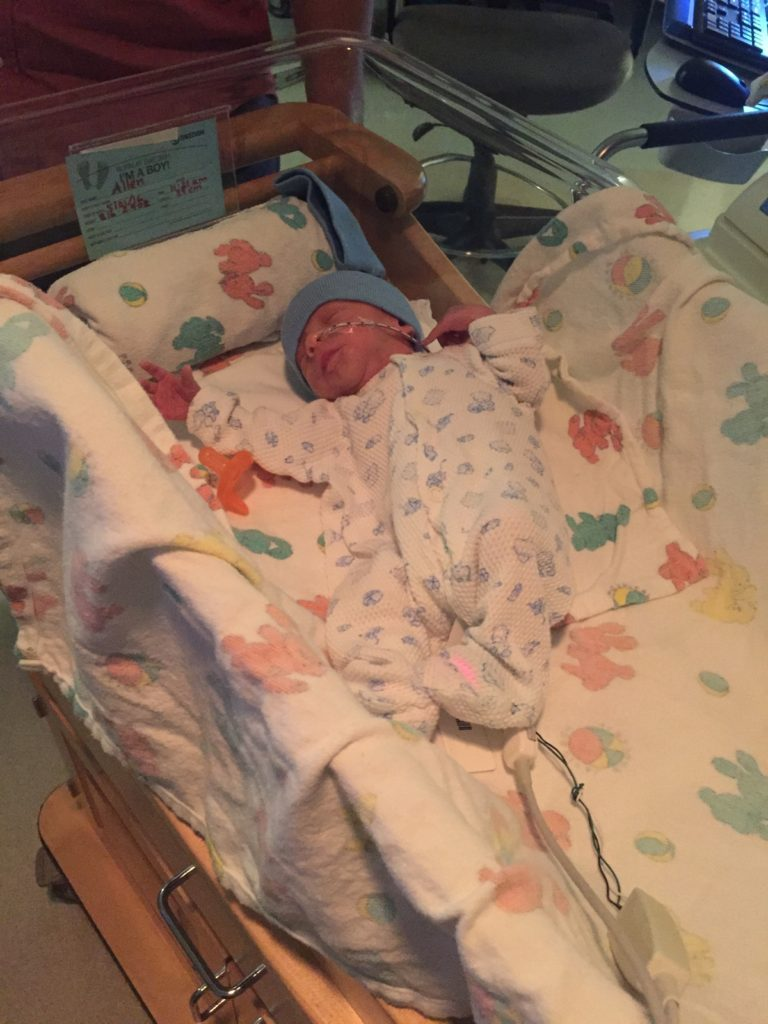 {Ben got dressed finally! The nurses collect outfits for the babies in the NICU, so Ben has a little drawer full of his own hospital clothes. And this is a picture of Ben in his open crib...}