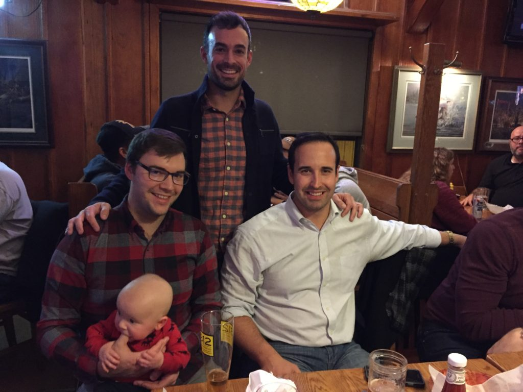 {Baby in a bar! AK, Alex's best man, and Dane, a lifelong friend, got to meet Ben too.}
