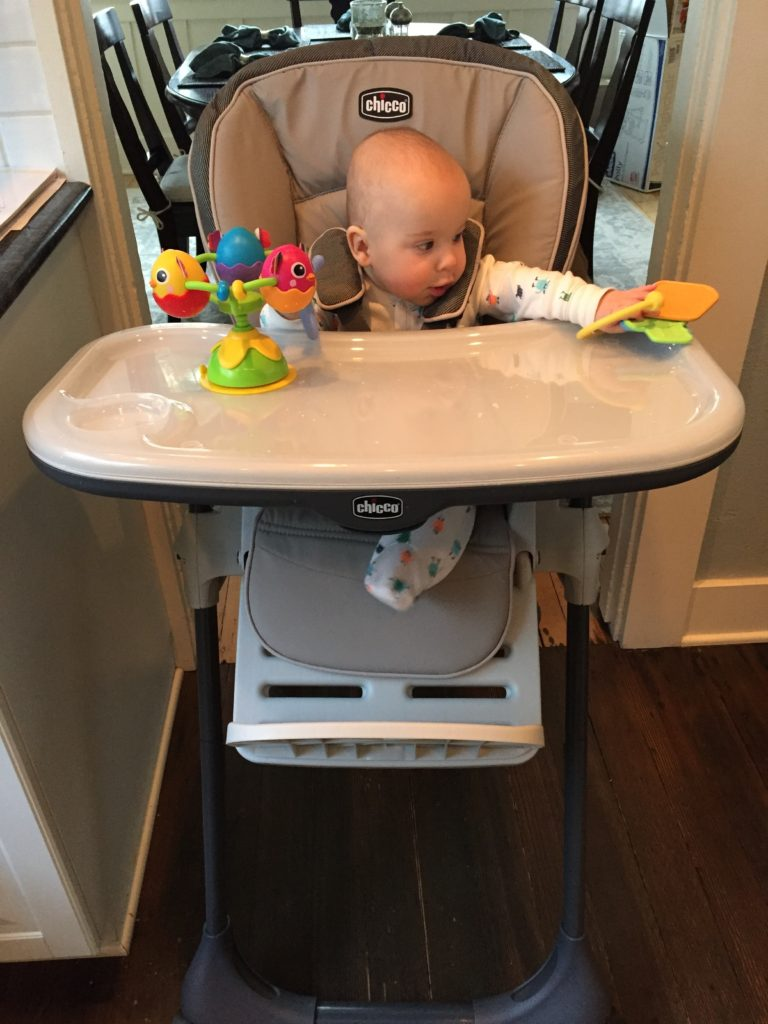 {Ben has grown to love his high chair! It's made it easier for me to adjust to his new morning routine of being awake longer.}