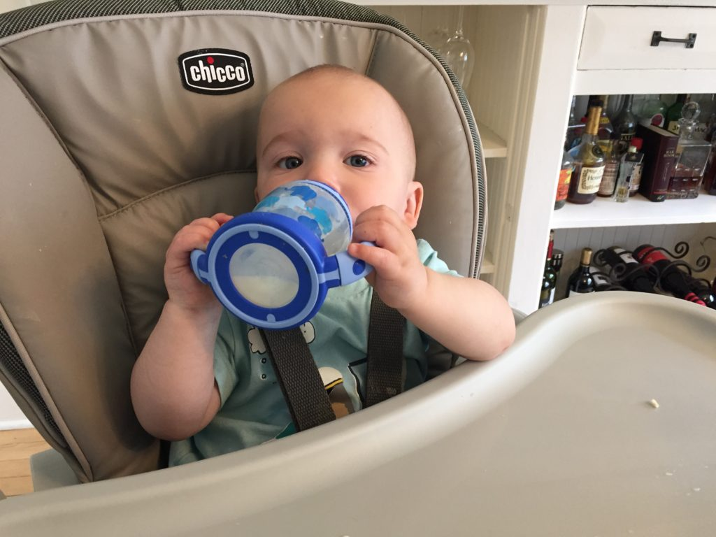 {Feeding himself with a sippy cup!}